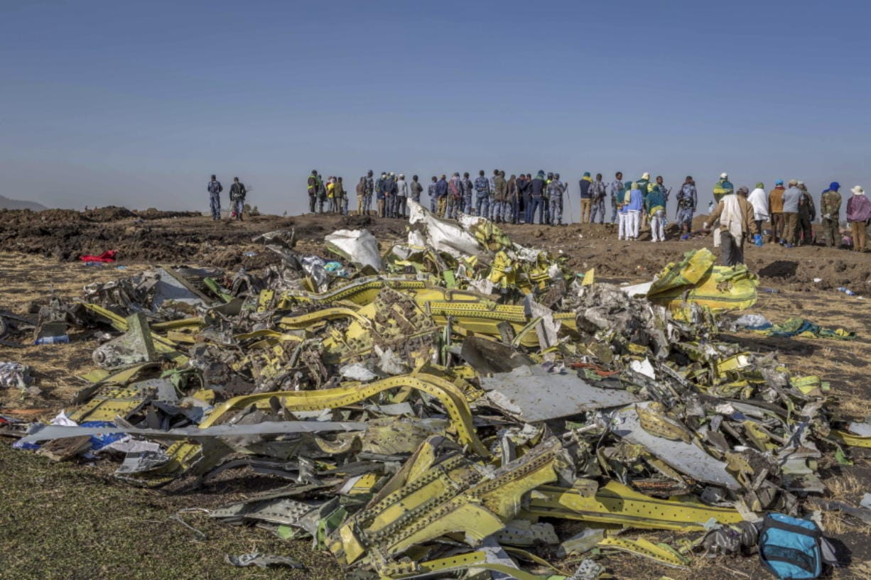 Wreckage is piled March 11, 2019, at the crash scene of Ethiopian Airlines Flight ET302 near Bishoftu, Ethiopia.