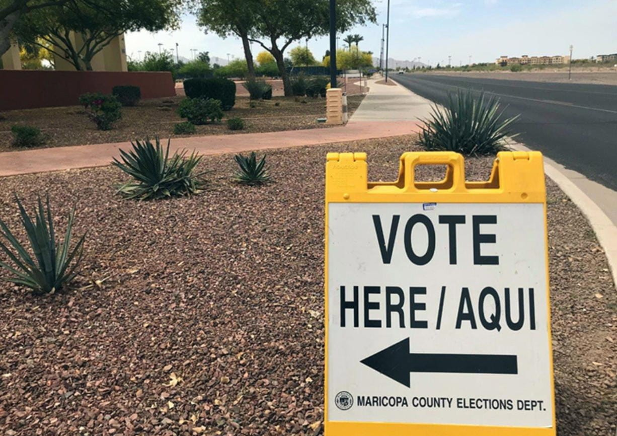 FILE - This April 11, 2018, file photo shows a sign directing voters to an early-voting location in Surprise, Ariz. Sharing the primary calendar Tuesday, March 17, 2020, are two states that represent different pieces of America: Ohio, a largely white state that's barely growing and looking to rebound from a decline in manufacturing, and Arizona, a state where one-third of the population is Latino and growth is exploding. One looks more like the nation's past, the other could be its future.