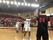 King's Way Christian senior Kobi Cason defends an inbounds pass late in the Knights' 58-57 overtime loss to River View on Friday at the 1A state basketball tournament in Yakima.