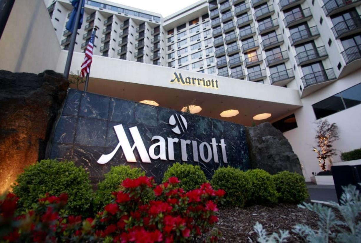 FILE - This April 20, 2011 file photo shows Portland Marriott Downtown Waterfront in Portland, Ore.  Marriott says guests' names, loyalty account information and other personal details may have been accessed in the second major data breach to hit the company in less than two years. The world's largest hotel company says on Tuesday, March 31, 2020, approximately 5.2 million guests may have been affected.