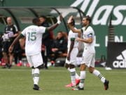 Portland Timbers' Diego Valeri, right, celebrates his goal with his teammate in an MLS soccer match against Nashville SC in Portland, Ore., Sunday, March 8, 2020.