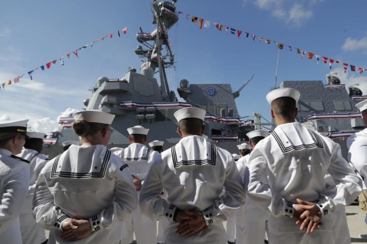 FILE - In this Saturday, July 27, 2019, file photo, sailors stand during a commissioning ceremony for the U.S. Navy guided missile destroyer USS Paul Ignatius, at Port Everglades in Fort Lauderdale, Fla. The U.S. Navy is releasing a strategy that describes plans to overhaul its approach to education because the nation no longer has a massive economic and technological edge over potential adversaries. (AP Photo/Lynne Sladky, File)