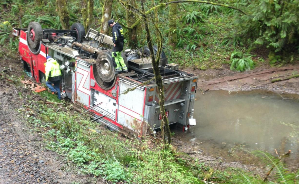 A Clark County Fire District 10 engine rolled over off a narrow unpaved road northeast of La Center on Monday. Crews were responding to a sick call.