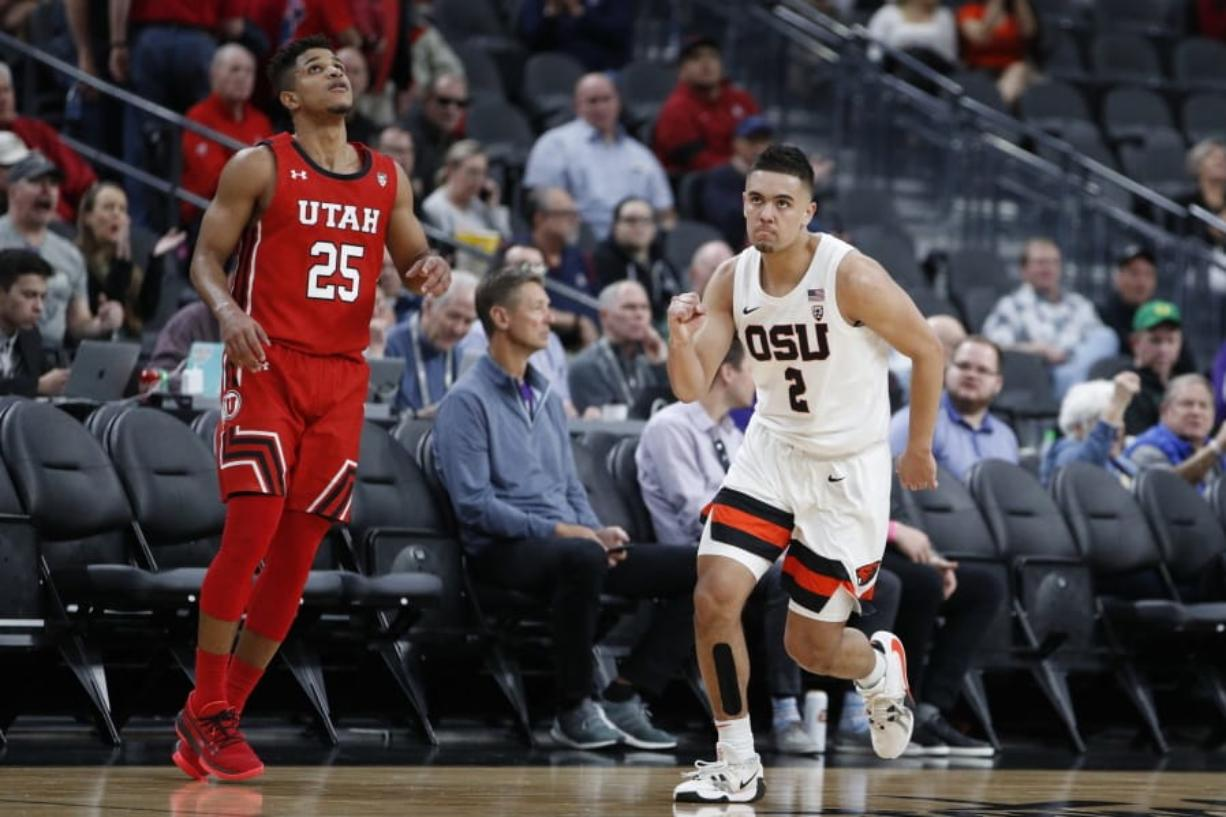 Oregon State's Jarod Lucas (2) celebrates after a play against Utah during the second half of an NCAA college basketball game in the first round of the Pac-12 men's tournament Wednesday, March 11, 2020, in Las Vegas.