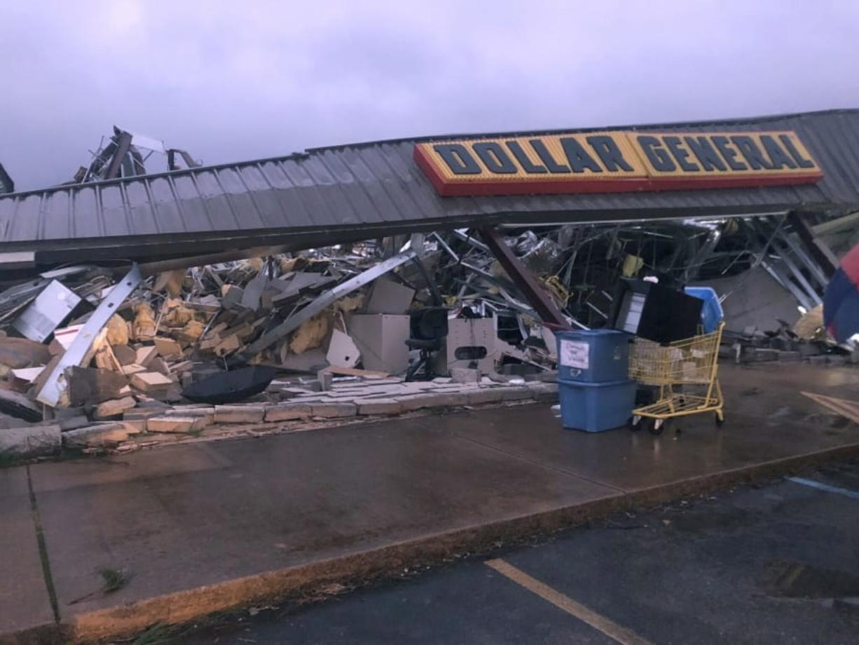 In this Tuesday, March 24, 2020 photo, a Dollar General store in Tishomingo, Miss., is completely destroyed after a suspected tornado swept through the area.