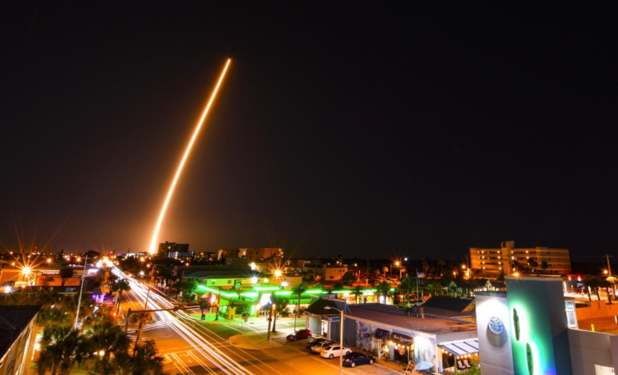 In a time exposure, a SpaceX Falcon is launched from Cape Canaveral, Fla., Friday night, March 6, 2020, with a load of supplies for the International Space Station. Cocoa Beach, Fla., is in the foreground.