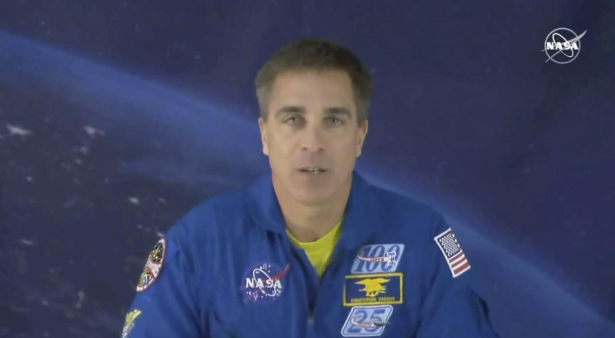 """In this image from video made available by NASA, astronaut Chris Cassidy speaks during an interview from cosmonaut headquarters in Star City, Russia, on Thursday, March 19, 2020. Cassidy, who's about to leave the planet for six months, is stressed about coronavirus like everyone else, even though he's already in heavy quarantine. Cassidy said Thursday that when you're an astronaut three weeks away from launch, lots of people are """"very concerned"""" about your health. He's grateful for that. (NASA via AP)"""