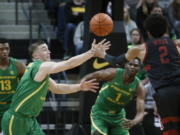 Oregon guard Payton Pritchard (3) steals the ball from Stanford guard Bryce Wills (2) during the first half of an NCAA college basketball game in Eugene, Ore., Saturday, March 7, 2020.