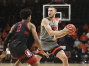 Oregon State's Tres Tinkle (3) passes around Stanford's Bryce Wills (2) during the first half of an NCAA college basketball game in Corvallis, Ore., Thursday, March 5, 2020.