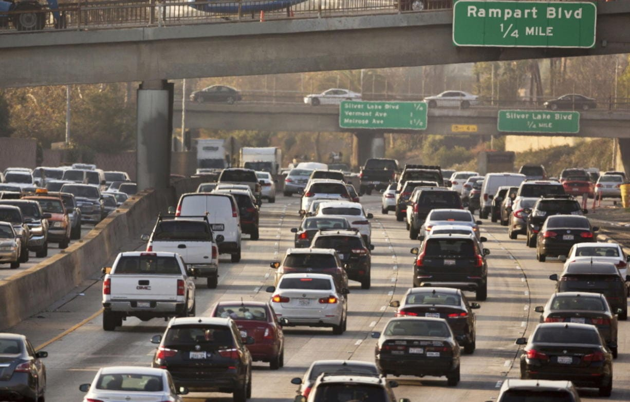 FILE - This Dec. 12, 2018, file photo shows traffic on the Hollywood Freeway in Los Angeles. President Donald Trump's is expected to mark a win in his two-year fight to gut one of the United States' single-biggest efforts against climate change, relaxing ambitious Obama-era vehicle mileage standards and raising the ceiling on damaging fossil fuel emissions for years to come.