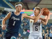 Olympia's Ethan Gahm fouls Union's Tanner Toolson on a fastbreak in a 4A State quarterfinal on Thursday at the Tacoma Dome.
