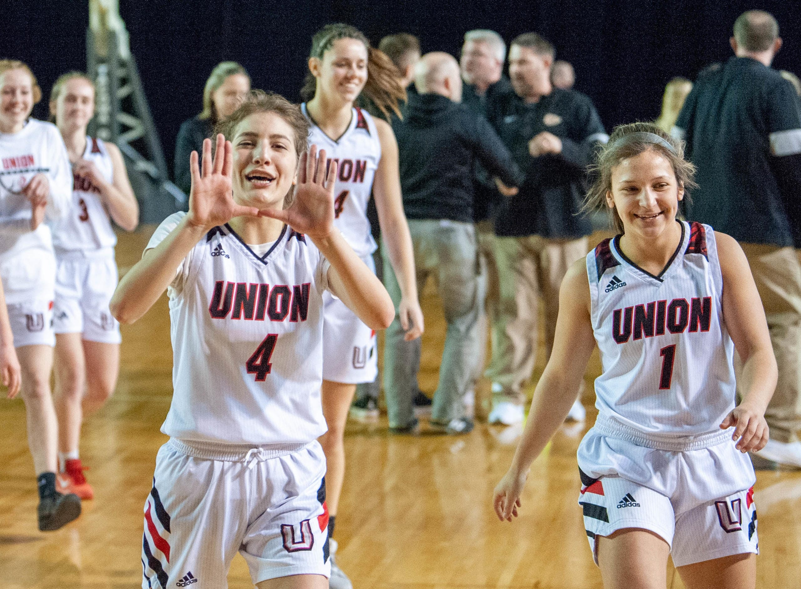 Union's Mason Oberg makes the U sign as she walks off the floor after a 4A State quarterfinal game on Thursday at the Tacoma Dome.  (Joshua Hart/The Columbian)