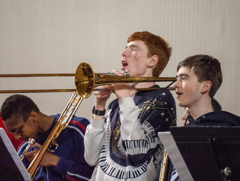 A Union band member sings in between playing the trumpet in a 4A State semifinal Friday at the Tacoma Dome. (Joshua Hart/The Columbian)
