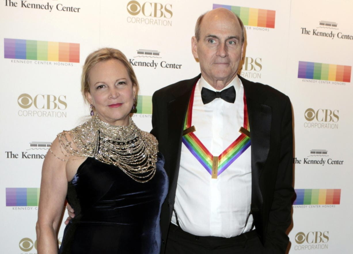 FILE - In this Dec. 4, 2016 file photo, Kim Taylor, left, and her husband James Taylor appear at the 39th Annual Kennedy Center Honors in Washington, D.C. The couple have donated $1 million to Massachusetts General Hospital in Boston to help with its battle against the spread of the new coronavirus. The gift, announced Tuesday, March 24, 2020, will help the hospital direct resources where the need is greatest, the hospital said in a statement.