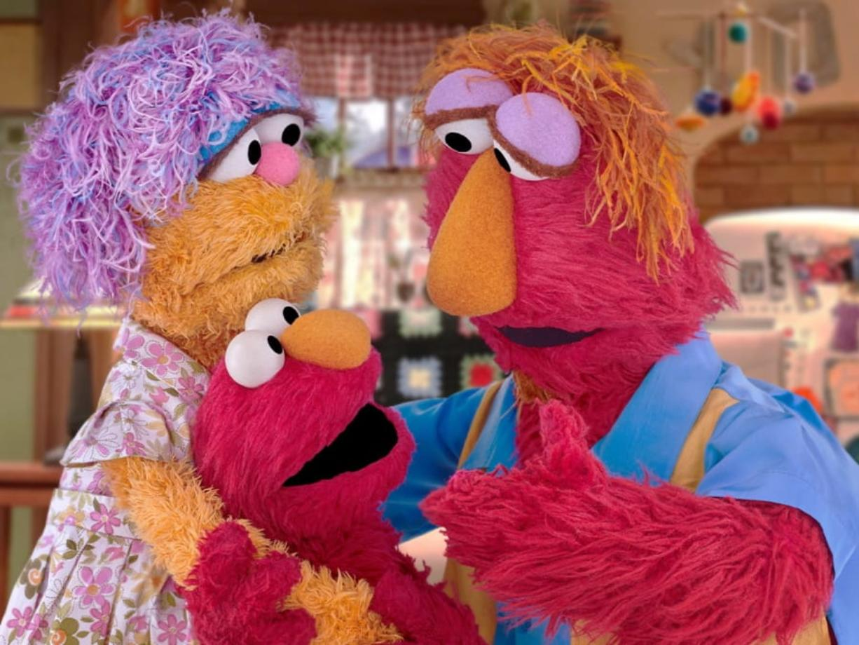 This undated image provided by Sesame Workshop shows Elmo and his parents Louie and Mae. Sesame Workshop announced Monday, March 30, 2020, that Elmo, Rooster and Cookie Monster are featured in some of four new animated public service spots reminding young fans to take care while doing such things as washing hands and sneezing. The content, which will be translated into 19 languages, is part of Sesame Workshop's Caring for Each Other initiative to help families stay physically and mentally healthy during the coronavirus pandemic.