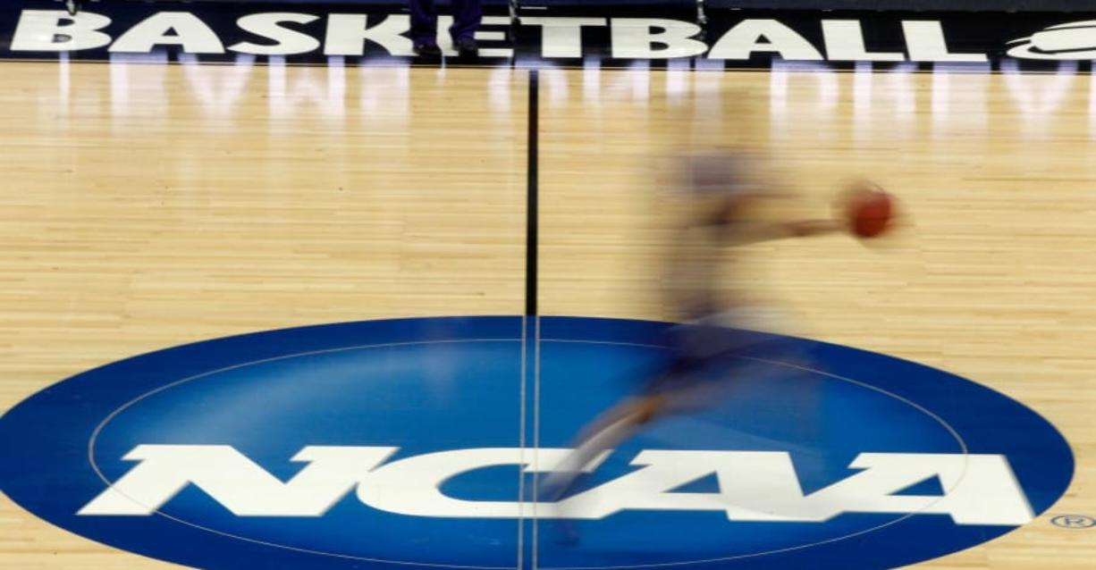 NCAA President Mark Emmert says NCAA Division I basketball tournament games will be played without fans in the arenas because of concerns about the spread of coronavirus.