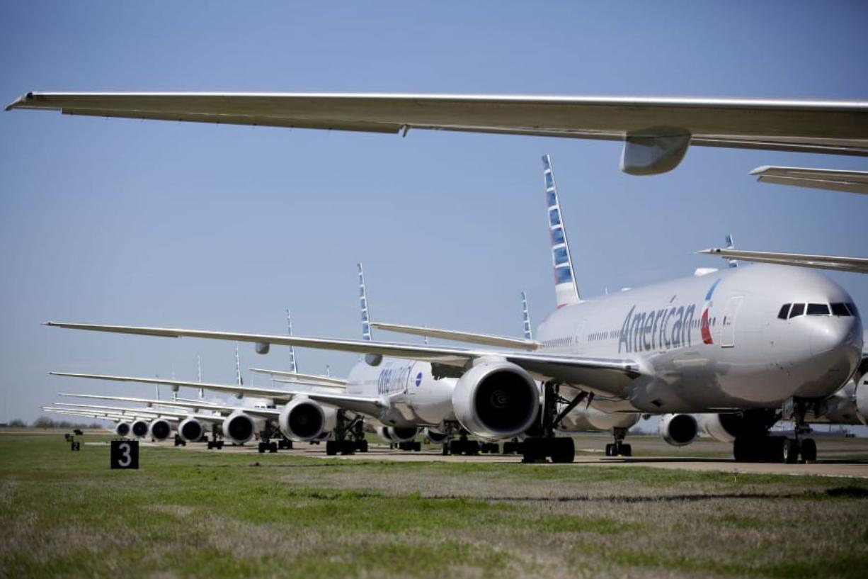 American Airlines 777's airplanes are parked at Tulsa International Airport Wednesday, March 25, 2020. American Airlines has 44 out of service airplanes parked at the airport due to a reduced flight schedule because of the COVID-19 coronavirus pandemic.