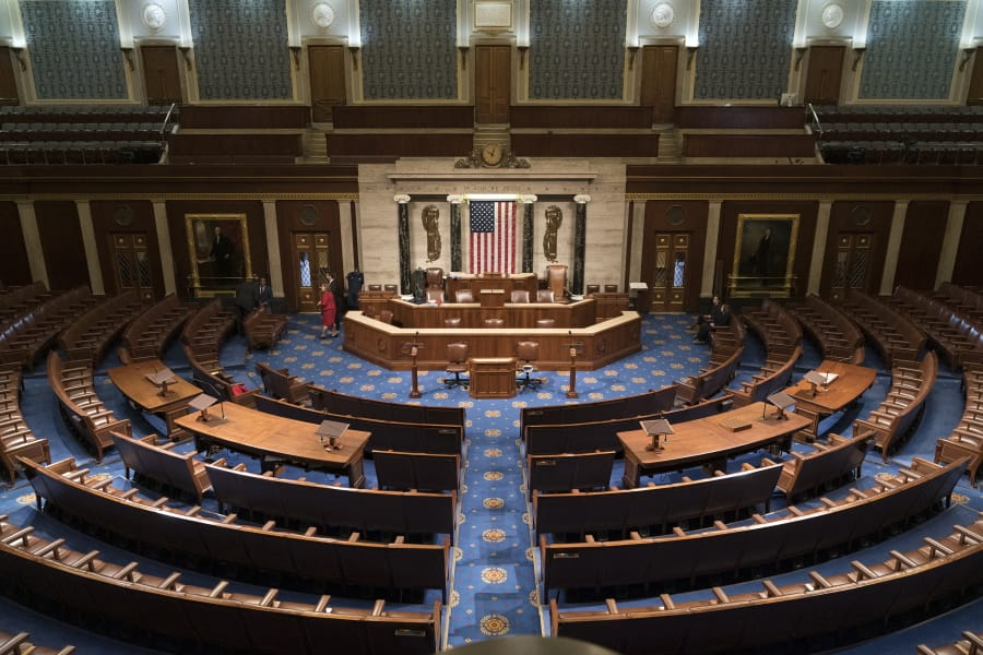 In this file photo from Jan. 3, 2019, the House of Representatives chamber is seen on the first day of the 116th Congress. The Covid-19 pandemic is raising the issue of how Congress should be able to function during times of national crisis as House members return to the Capitol, Friday, March 27, 2020, to pass a $2.2 trillion package to ease the coronavirus pandemic's devastating toll on the U.S. economy and health care system. (AP Photo/J.