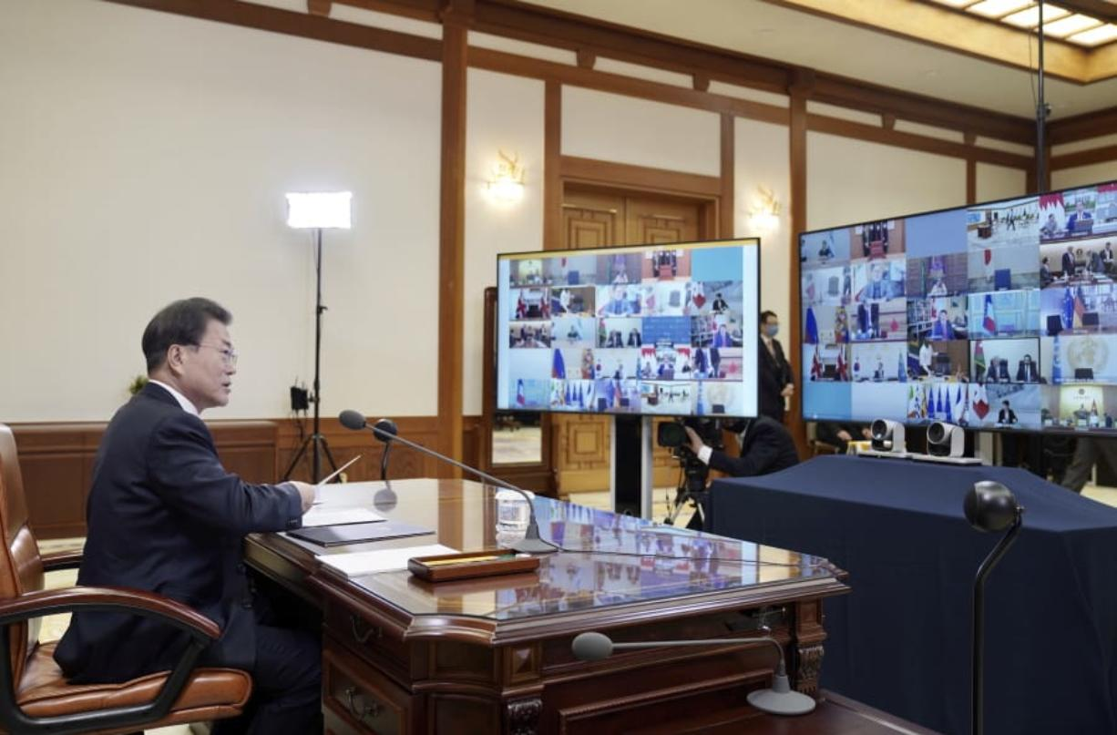 In this photo provided by South Korea Presidential Blue House via Yonhap News Agency, South Korean President Moon Jae-in attends G-20 virtual summit to discuss the coronavirus disease outbreak at the presidential Blue House in Seoul, South Korea, Thursday, March 26, 2020. Leaders of the world's most powerful economies will convene virtually to coordinate a response to the fast-spreading new coronavirus. The new coronavirus causes mild or moderate symptoms for most people, but for some, especially older adults and people with existing health problems, it can cause more severe illness or death.