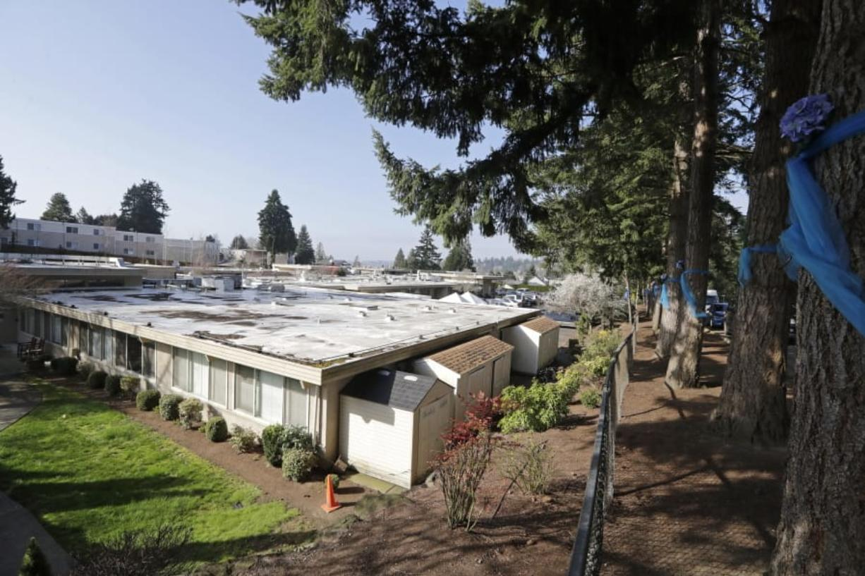 The single-story Life Care Center is seen Wednesday, March 18, 2020, in Kirkland, Wash. Staff members who worked while sick at multiple long-term care facilities contributed to the spread of COVID-19 among vulnerable elderly in the Seattle area, federal health officials said Wednesday.