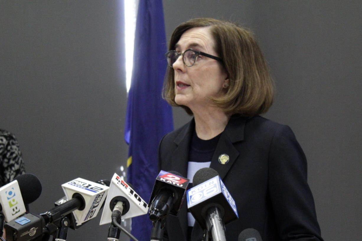 Gov. Kate Brown speaks at a news conference to announce a four-week ban on eat-in dining at bars and restaurants throughout the state Monday, March 16, 2020, in Portland, Ore. Restaurants can still offer take-out and delivery. The order is intended to slow the spread of the new coronavirus in Oregon and mirrors similar bans elsewhere, including Washington state.