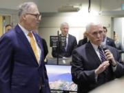 Vice President Mike Pence, right, speaks with Gov. Jay Inslee at the Washington State Emergency Operations Center, Thursday, March 5, 2020 at Camp Murray in Washington state. Pence was visiting to discuss Washington state's efforts to fight the COVID-19 coronavirus. (AP Photo/Ted S.