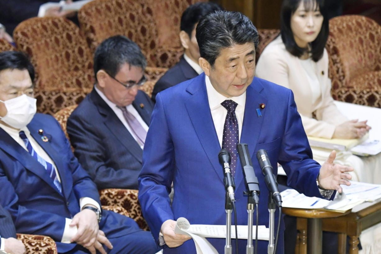 Japan's Prime Minister Shinzo Abe speaks at a parliamentary session in Tokyo Monday, March 23, 2020. Abe said a postponement of Tokyo Olympics would be unavoidable if the games cannot be held in a complete way because of the coronavirus pandemic.