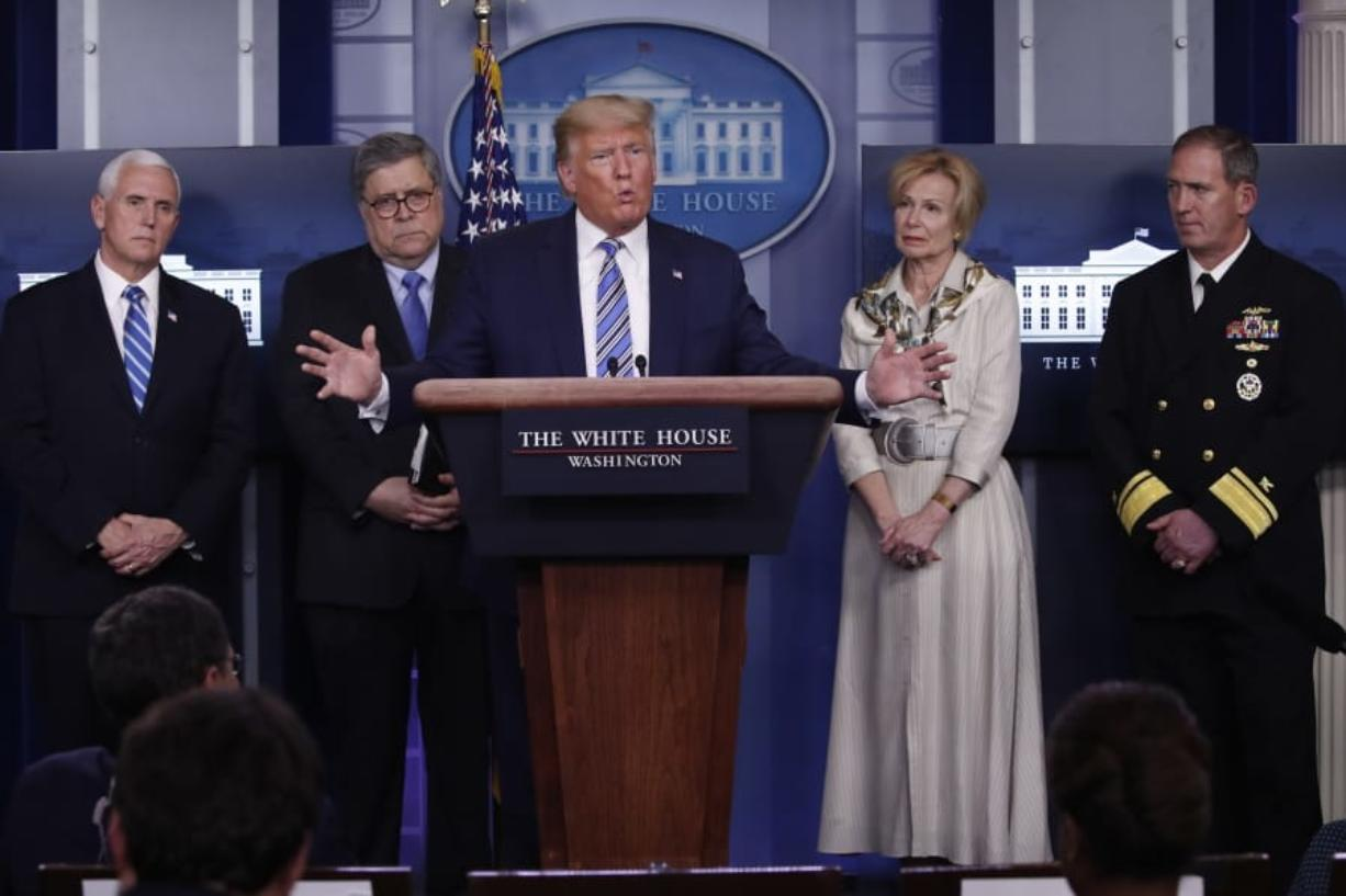 President Donald Trump takes questions from reporters as he speaks about the coronavirus in the James Brady Briefing Room, Monday, March 23, 2020, in Washington. Listens from left are Vice President Mike Pence, Attorney General William Barrm Dr. Deborah Birx, White House coronavirus response coordinator, and Navy Rear Adm.