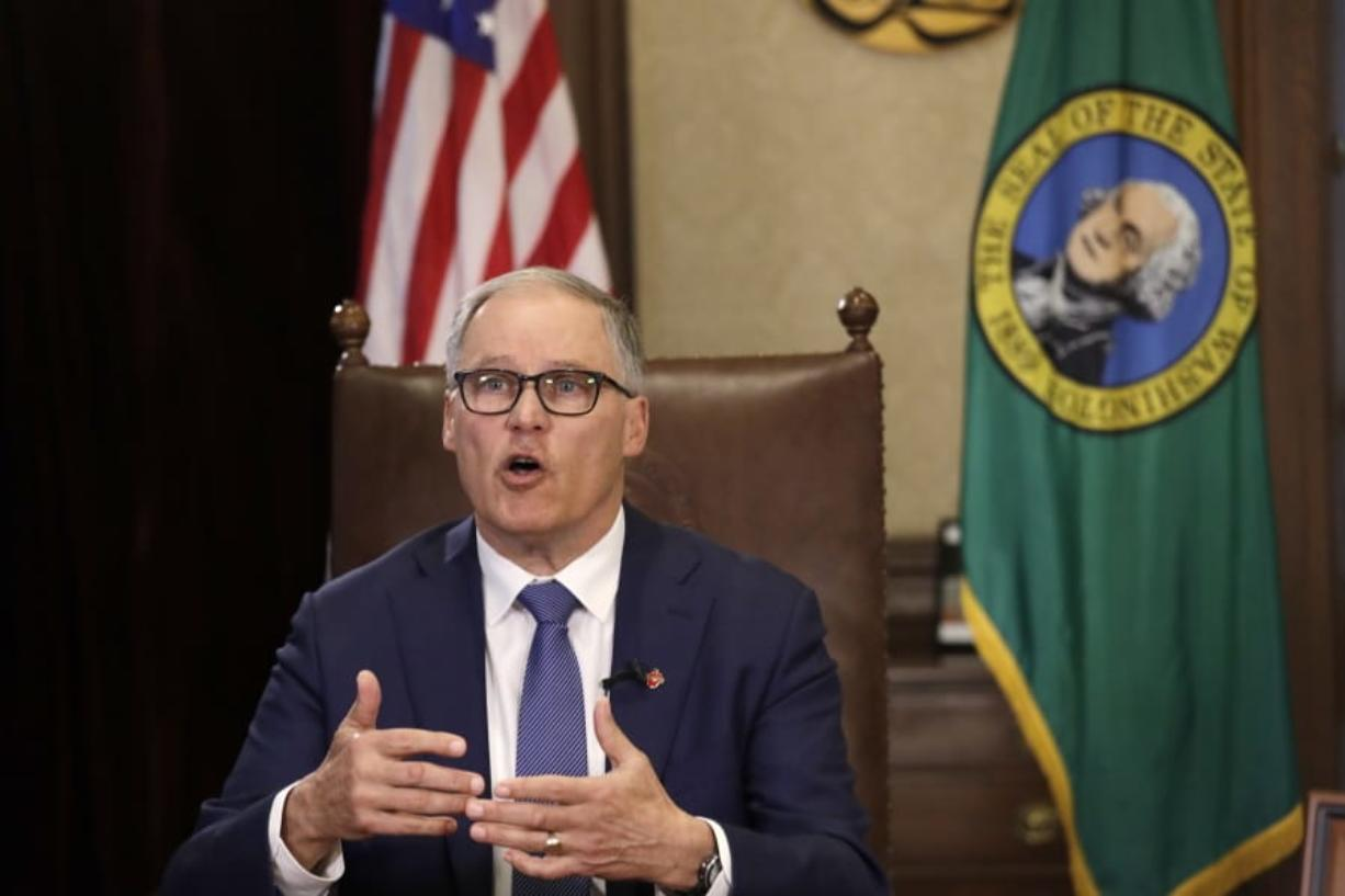 Washington Gov. Jay Inslee practices as he prepares to speak about additional plans to slow the spread of coronavirus before a televised address from his office Monday, March 23, 2020, in Olympia, Wash. Inslee has ordered non-essential businesses to close and the state's more than 7 million residents to stay home unless necessary in order to slow the spread of COVID-19.