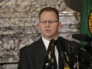 State Superintendent of Public Instruction Chris Reykdal talks to the media about the decision to close schools in three counties in response to COVID-19, Thursday, March 12, 2020, in Olympia, Wash. All public and private K-12 schools in King, Pierce and Snohomish counties will be closed for six weeks, and Gov. Jay Inslee said there could be closures in more counties soon.