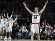 Gonzaga's Corey Kispert (24) celebrates after a teammate scored a 3-point shot against Saint Mary's in the first half of an NCAA college basketball game in the final of the West Coast Conference men's tournament Tuesday, March 10, 2020, in Las Vegas.