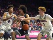 Arizona forward Josh Green (0) and Nico Mannion pressure Washington State forward CJ Elleby (2) in the first half of an NCAA college basketball game Thursday, March 5, 2020, in Tucson, Ariz.