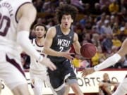 Washington State forward CJ Elleby (2) drives past Arizona State guard Alonzo Verge Jr. (11) during the first half of an NCAA college basketball game Saturday, March 7, 2020, in Tempe, Ariz.