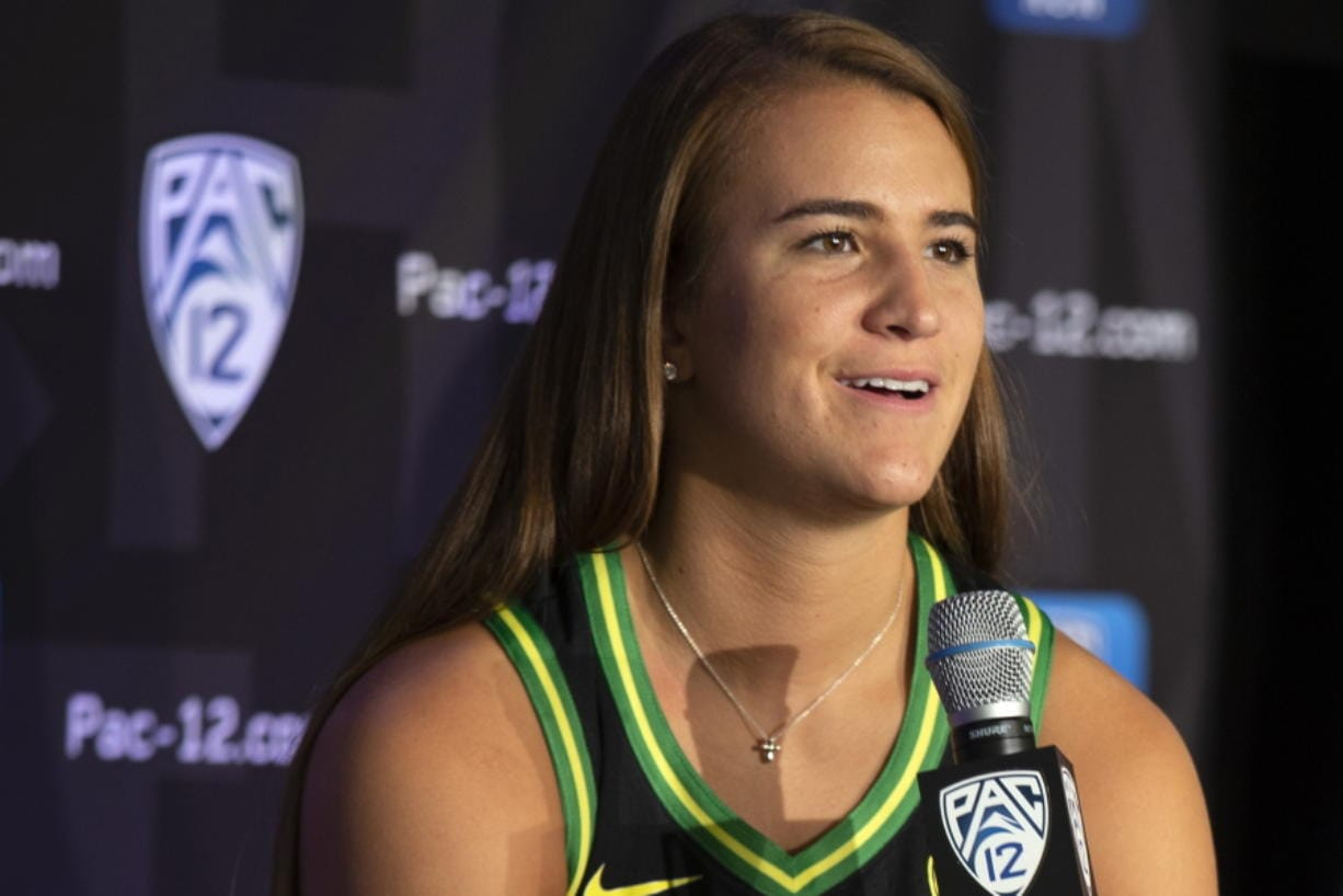 Oregon's Sabrina Ionescu earned a spot on The Associated Press women's basketball All-America team Thursday, March 19, 2020, as a unanimous choice from the national media panel that votes on the Top 25 each week.  (AP Photo/D. Ross Cameron, File)