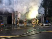 Clark County Fire & Rescue personnel battle a barn fire on 239th Street.