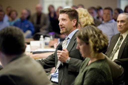 Paul Dennis, then- executive director of the Camas Washougal Economic Development Association, speaks to a joint meeting of the Camas and Washougal city councils in 2011.