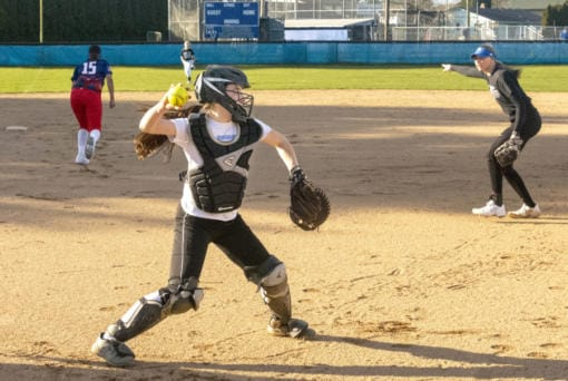 Mountain View catcher Kinsey Martin fields a bunt and fires to first base as Sydney Brown calls out in the background during a practice on March 11.