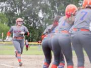 Ridgefield seniors Mia Tomillo, left, is a key piece for the Spudders on the softball field.
