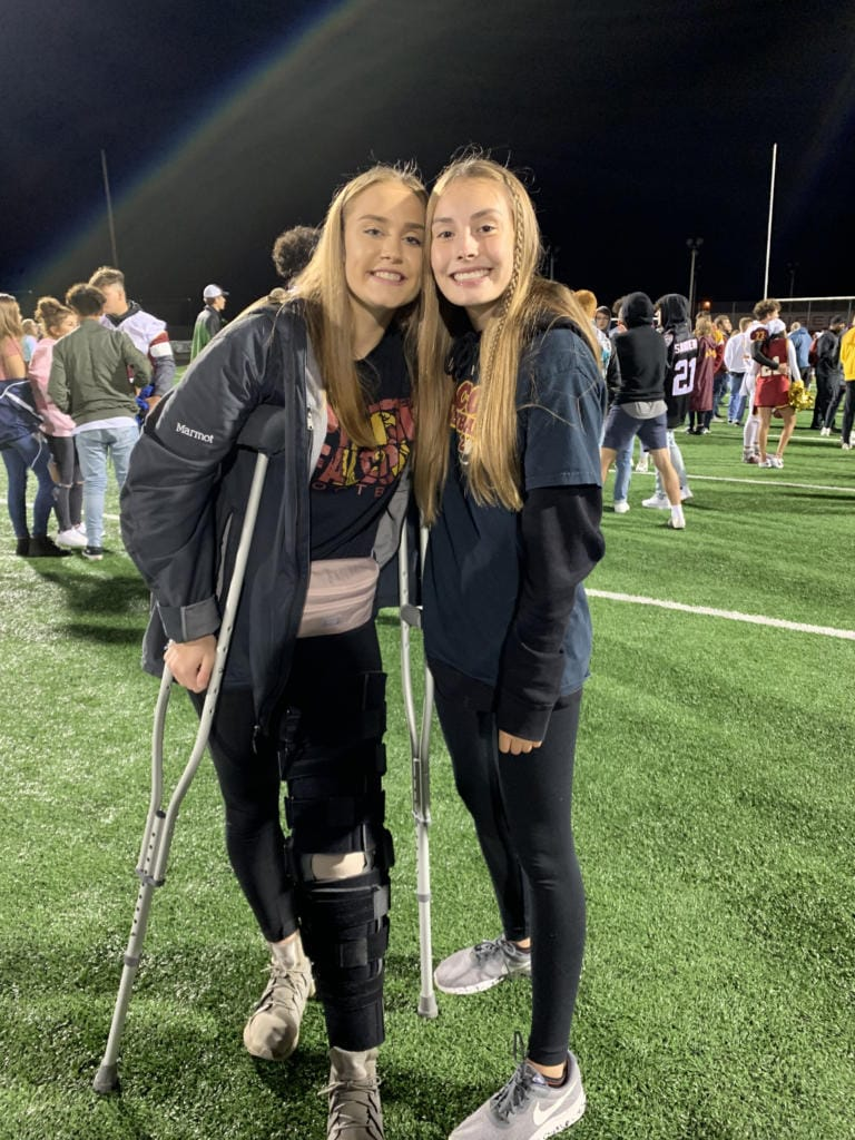 Amelia Renner, left, with friend Jordan Peterson at a Prairie football game in October (Photo provided by Renner family)