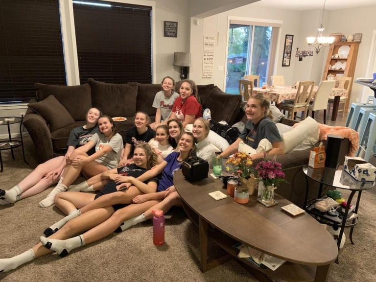 The Prairie High volleyball team enjoys a team dinner in the Renner home after Amelia's first knee surgery (Photo provided by the Renner family)