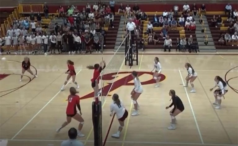 A screen grab from the video when Prairie'a Amelia Renner (in white, bottom of frame) suffered a traumatic knee injury in volleyball match last September.