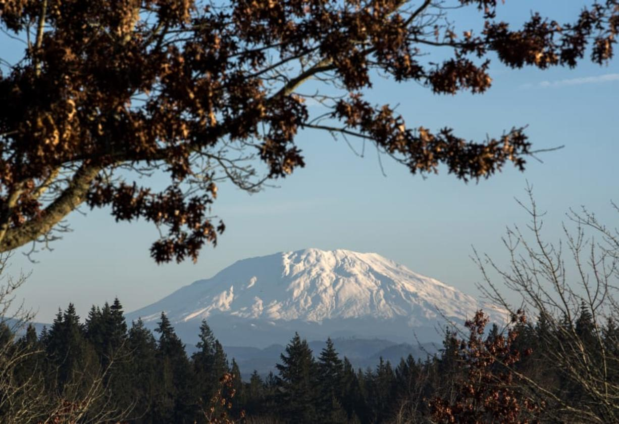 A fresh blanket of snow is visible on Mount St. Helens from the Washington State University Vancouver campus on Dec. 6, 2018. Seasonal temperatures in the upper 40s and lows in the upper 30s to low 40s are expected throughout the weekend.