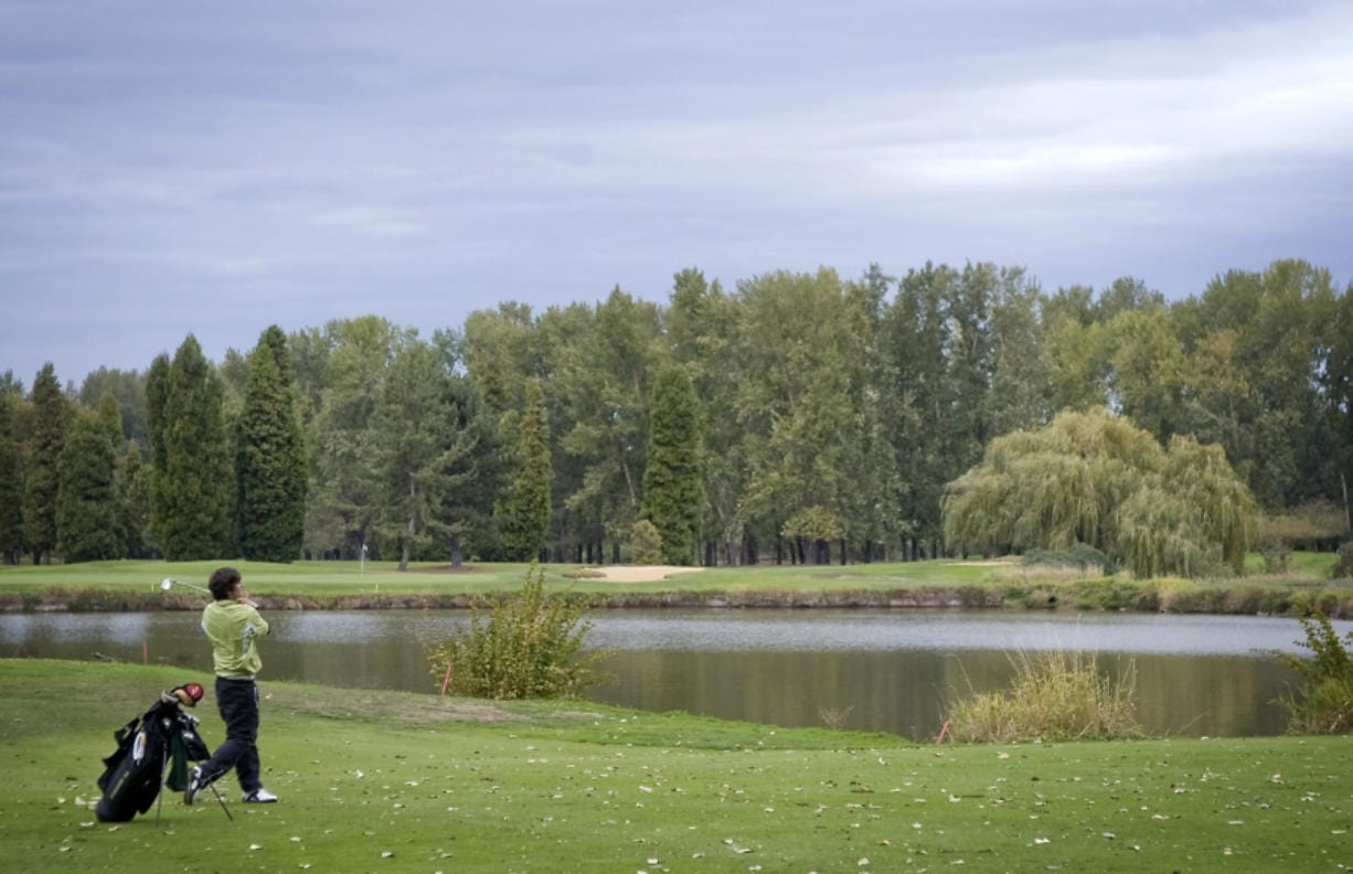 Portland area golf courses like Heron Lakes are seeing an influx of players from Southwest Washington with courses in Washington shut down due to pandemic concerns.