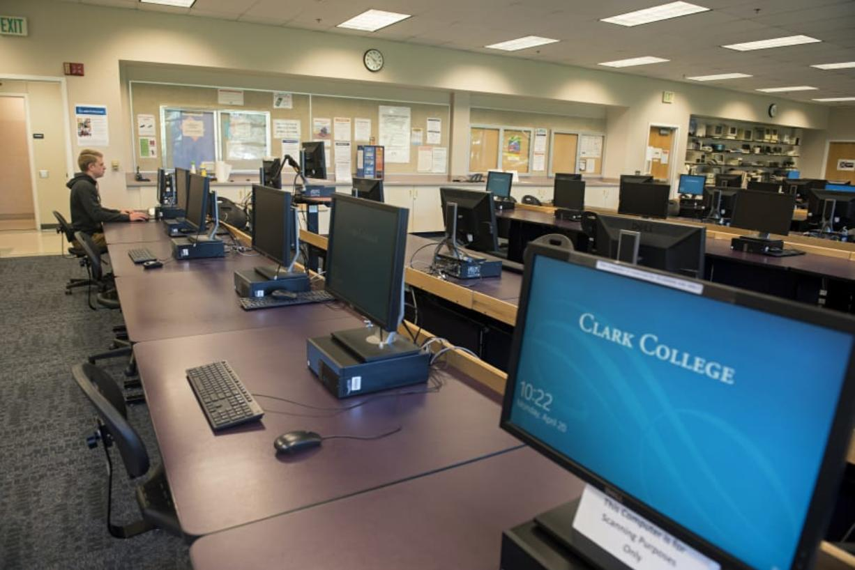 Clark College student Alex Belza, 16, works in an empty computer lab at Scarpelli Hall that allowed extra space for social distancing on Monday morning. Clark College announced on Friday it would extend distance learning through the fall quarter.