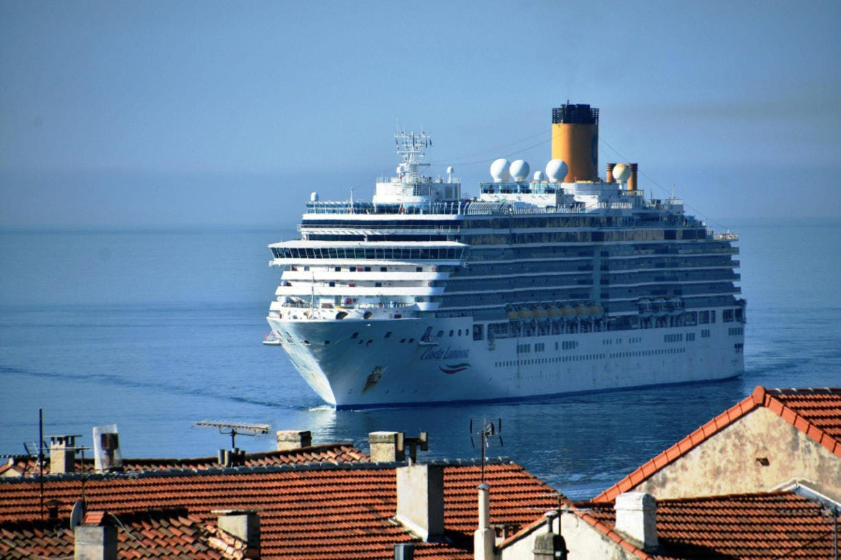 """Suspected of carrying passengers who are infected with the coronavirus, the Italian cruise """"Costa Luminosa"""" arrives on March 19, 2020, in the French Mediterranean port of Marseille, with more than 1,400 people on board."""