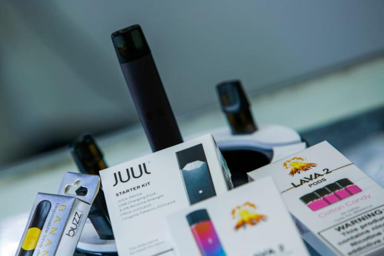 JERSEY CITY, NJ - JANUARY 02: E-cigarettes devices are display in a local store on January 2, 2020 in Jersey City, New Jersey. The Trump administration will announce this week the ban for mint-, fruit- and dessert-flavored e-cigarette cartridges, but allow menthol and tobacco flavors to remain on the market.