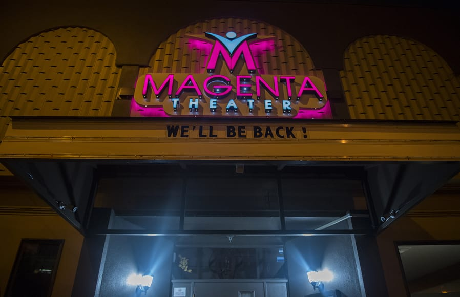 A sign outside Magenta Theater on Main Street in downtown Vancouver reassures the public of their return, as seen March 27.