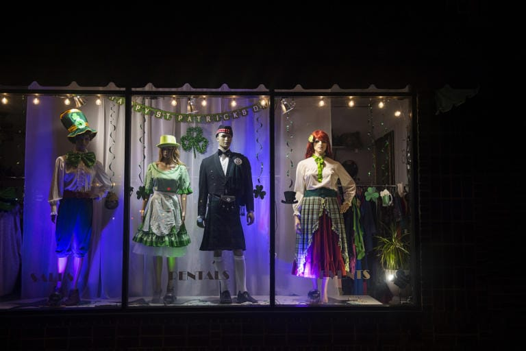 Time seems to stand still as mannequins at Center Stage Clothiers still wear outfits for a St. Patrick's Day celebration that didn't happen this year, as seen March 27. (Amanda Cowan/The Columbian)