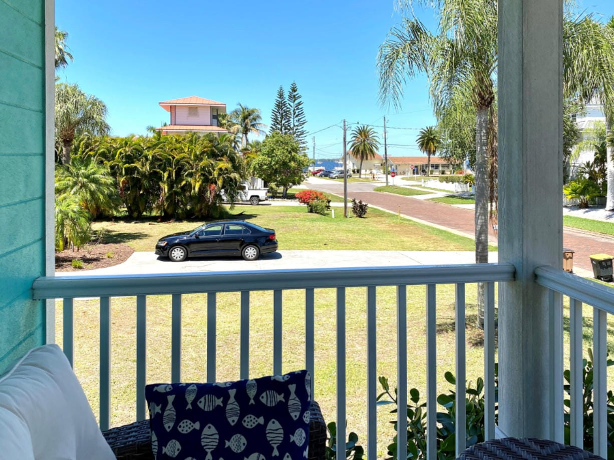 Sheltering in place from our Florida winter home, where we spend much of our time on our front porch.