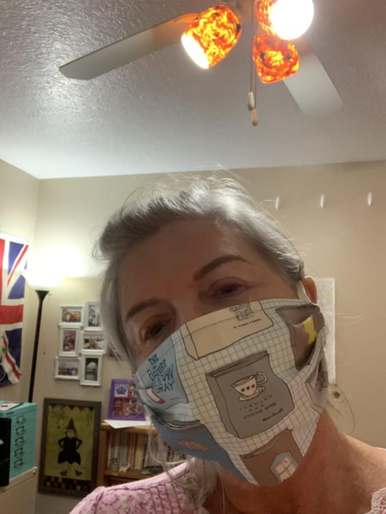 Jaynie Roberts is pictured with one of her homemade masks at her home in Vancouver.